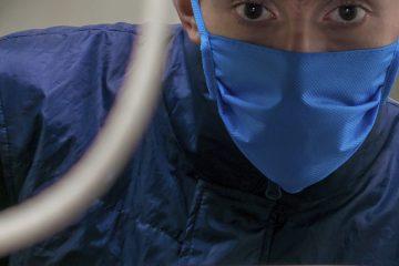 IT employee wearing face mask