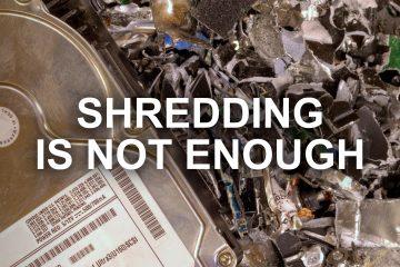 hard drive on shredded hard drive pieces